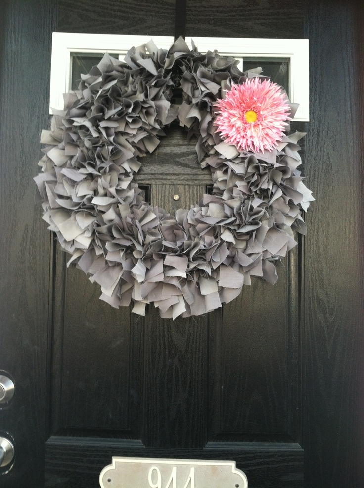 Grey fabric wreath. Used a lot of grey fabric strips in 2 different shades. Used a flower clip to conplete. I loved how it turned out.
