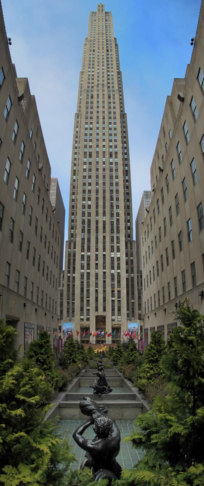 Pedestrian mall at rockefeller center with the ge building in the background new york