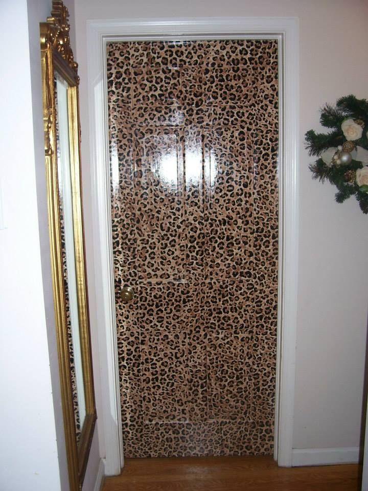 Hand painted leopard door for little girls bedroom.