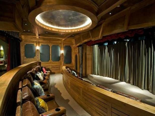 Home theater...interesting.  I'd have higher-back chairs, no wood separators, no curtain, darker color scheme.