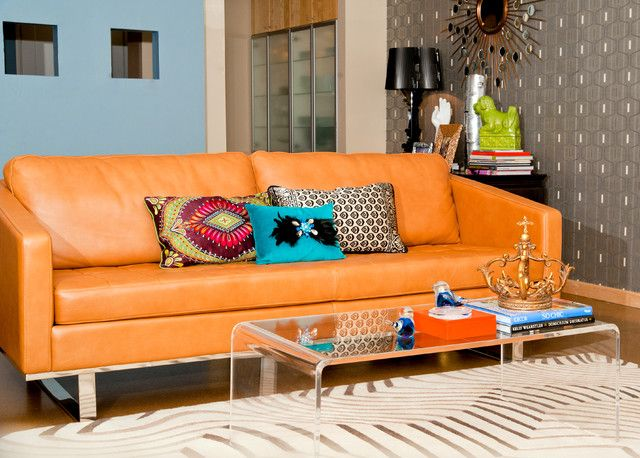 Wonderful and Colorful Living Room Design Applied Acrylic Coffee table and Leatehr Orange Sofa and Colorful Pillows on Zebra Carpet : Inspirational Interior and Exterior Home Design Ideas – TheMakaroni.com