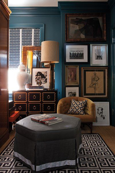 Dark teal walls, wood floor, gallery pics.   Masculine sophistication {David Jimenez}