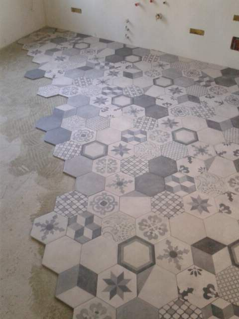 Terra Series tile seen at Ames...maybe choose a decorative tile each for the bathroom and one for the kitchen?