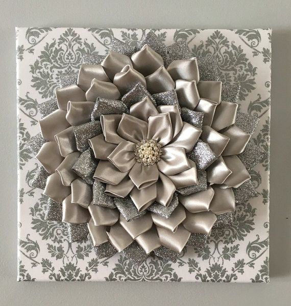 This listing is for 1 Ribbon glitter silver and gray Kanzashi Flower on silver glitter damask canvas wall art. Add some color and texture to any wall in any room. Set on 12x12 canvas this beautiful satin ribbon Kanzashi in Baby Pink will add color and wow to that plain wall in your home, nursery or office. The embellishment in the center of the flower just give it that little extra more.  Please respect the time and effort it takes to create these pieces. Definitely respect the artist by not…