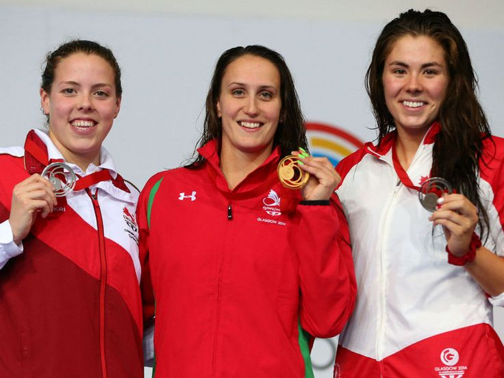 Georgia Davies (centre) of Wales took gold in the 50m backstroke, helping to add to her country's medal tally in the pool