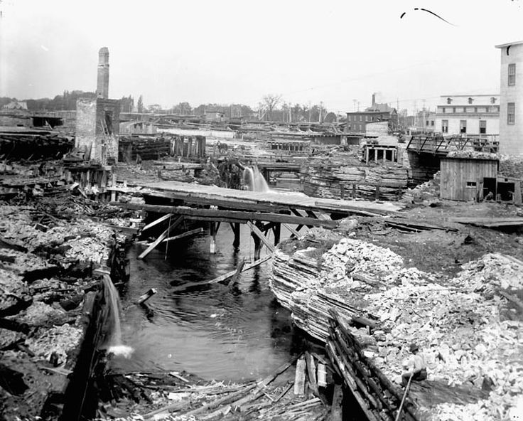 """The ""chasm"" at former Hurdman Sawmill site, Chaudière Falls, Hull, Quebec. View North-West with E.B. Eddy Company at right. 1902 (photo by Bronson, Credit: Topley Studio / Library and Archives Canada / PA-028242)    Jennie Anderson onto L'histoire ouvrière (Hull, QC)"