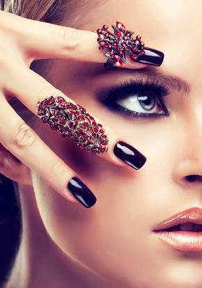 Model with burgundy manicure and fashion rings