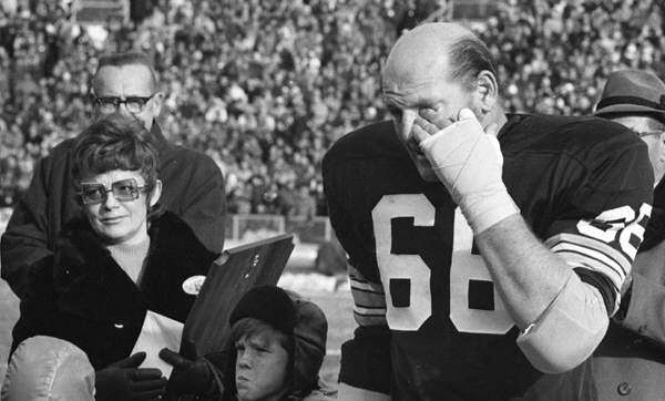 Surrounded by Jackie Nitschke and other family members, Ray Nitschke wipes away a tear as he receives an ovation from Packers fans at Lambeau Field during Ray Nitschke Day festivities on Dec. 31, 1971.