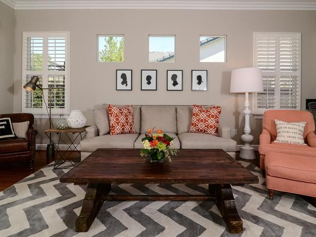 An eye-catching chevron area rug defines the sitting area of this transitional living room. A sofa and two chairs offer plenty of room for family and friends, while a large wood coffee table acts as a catchall and display space.