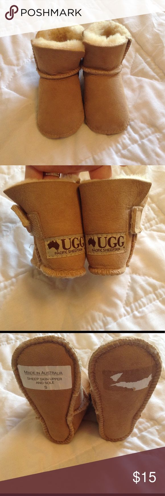 Baby UGG boots Real UGG boots we bought in Australia. Size small but because of thickness of the lambs wool they fit snug for approximately size 6-12months. UGG Shoes Boots