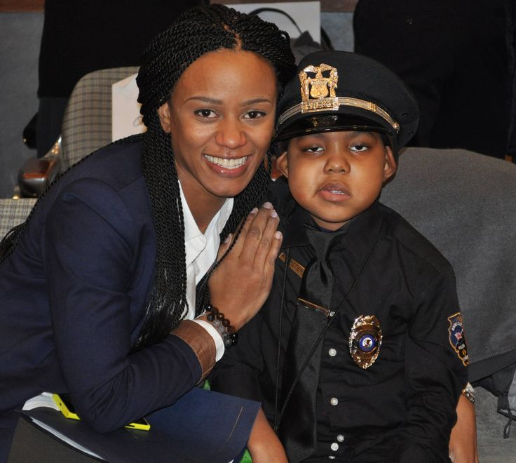 Angela Peterson with her son, A.J., who was sworn in as a Round Lake junior reserve police officer at Monday's village board session.