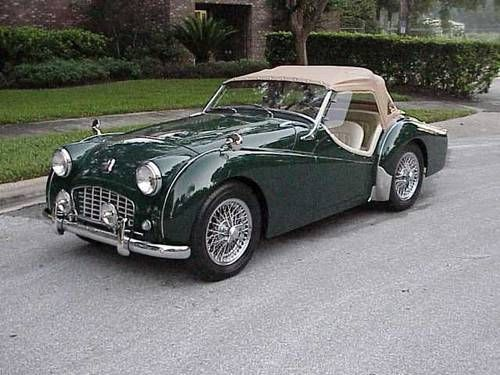 1956 Triumph TR-3, ducoed in british racing green, with beige upholstery, features 2.2litre engine. One of Britain's finest sports roadsters. bv@e.