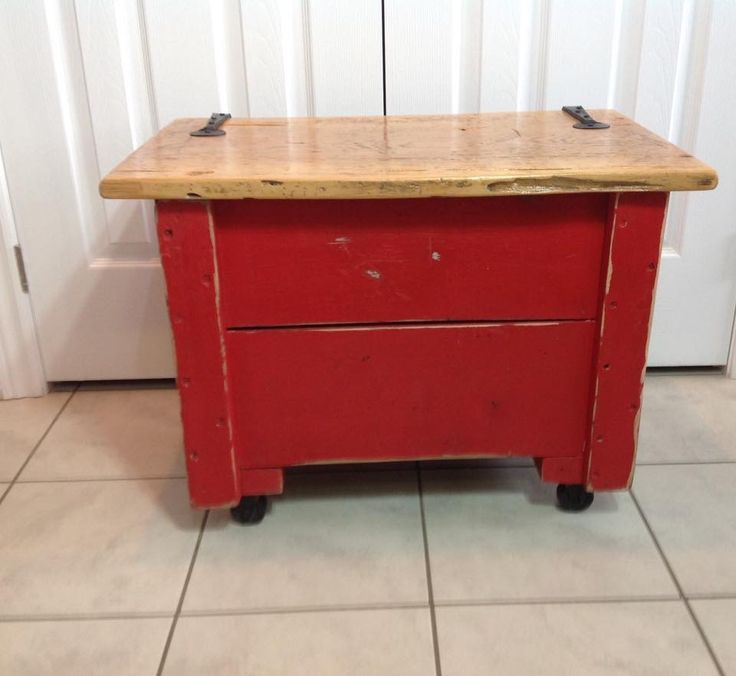 Old handmade cart on wheels with hinged lid finished in Fusion mineral paint Fort York Red makes a great printer stand