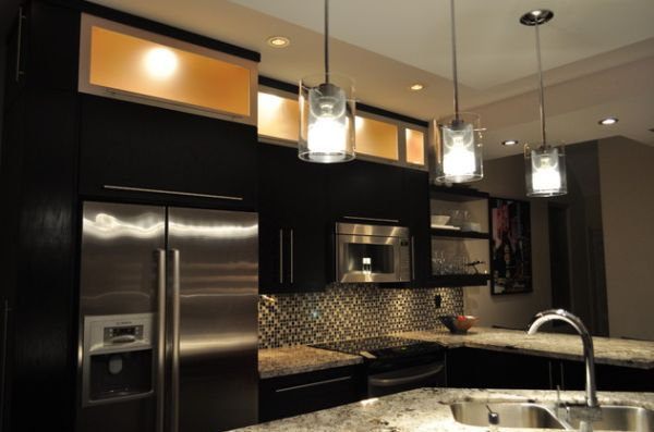 Divine looking pendant lights brighten up this otherwise dark kitchen