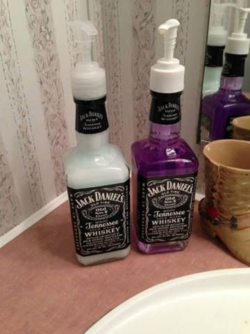 Using empty JD bottles as soap dispensers. Great idea for a man cave rest room.