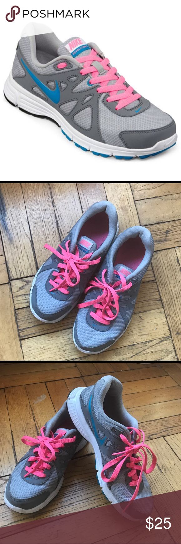 NIKE Revolution 2 Running Sneakers Gently used Nike Revolution 2 running sneakers. size 7. Gray, blue and pink. Main flaw is the Nike swish on the inside on both shoes is wearing off (pictured). Comes from pet and smoke free home. Nike Shoes Sneakers