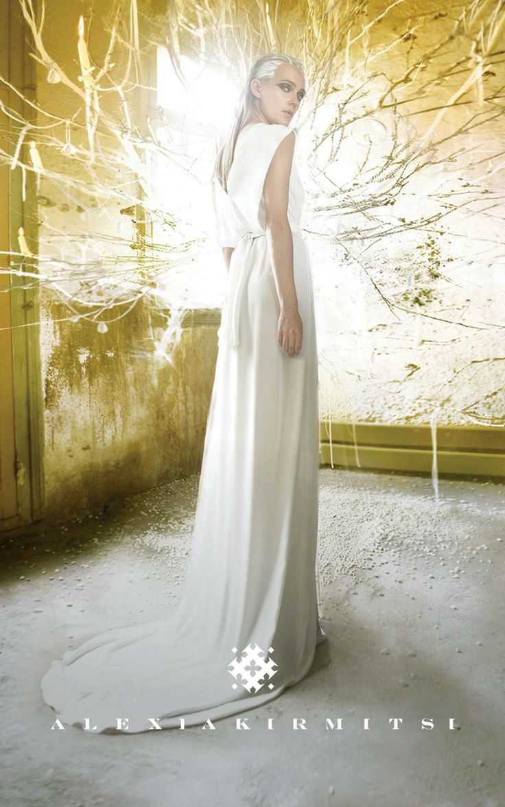 Wedding dress in matt antisilk. Minimal design, clean and neat. Open back with long tail. Feeling of air and flow.