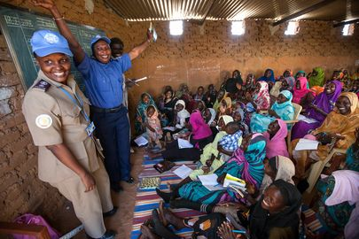 Women in Abu Shouk Camp for internally displaced persons (IDPs) near El Fasher, North Darfur, attend English classes conducted by volunteer teachers and facilitated by the police component of the African Union-United Nations Hybrid Operation in Darfur (UNAMID). 18 February 2014. UN Photo/Albert González Farran
