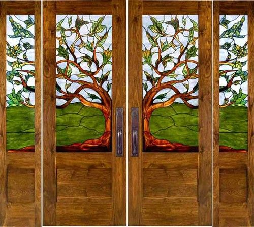 Stained Glass Doors. The stain glass pattern carried through all these panels is absolutely beautiful. I love the tree motif and unique vista it provides.   Please contact California Architectural Traditions for pricing.