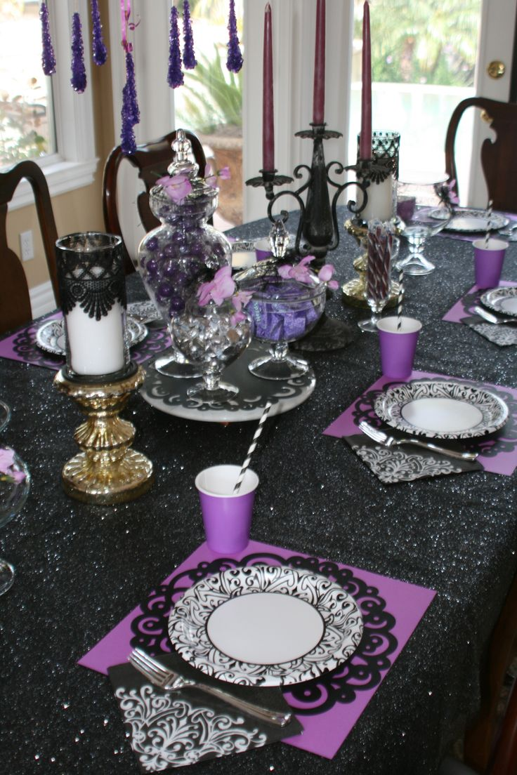 """Maleficent Party - Table is set for Maleficent  friends in time for the premier!   Kisses as """"True Love's Kiss,"""" Gumballs as """"Aurora/Briar Rose Berries,"""" and Nerds as """"Fairy Dust.""""  Placemats are scrapbook paper with black paper doily from Michael's.   Candles are dollar store vase as hurricane edged with lace from Joann's. #Maleficent"""
