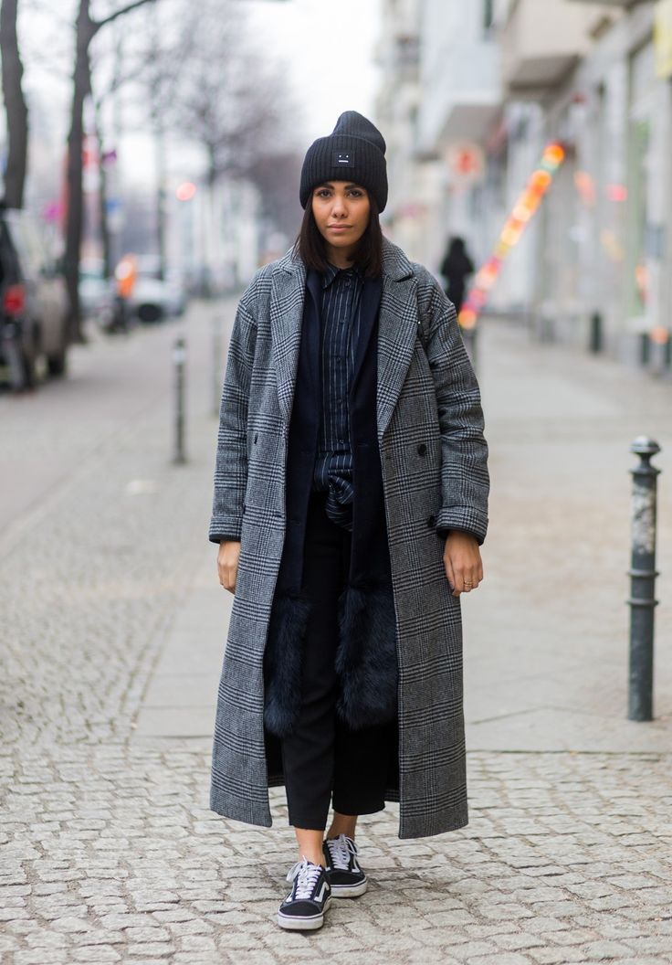 storm wears acne studios beanie with asos coat and victoria Beckham blouse for berlin fashion week taken by thestyleograph
