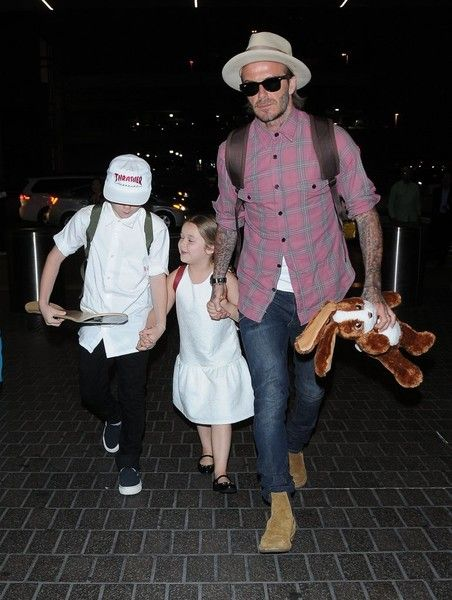 David Beckham Photos Photos - David Beckham and his children departing on a flight at LAX airport in Los Angeles, California on April 17, 2017. David Beckham & His Kids At LAX