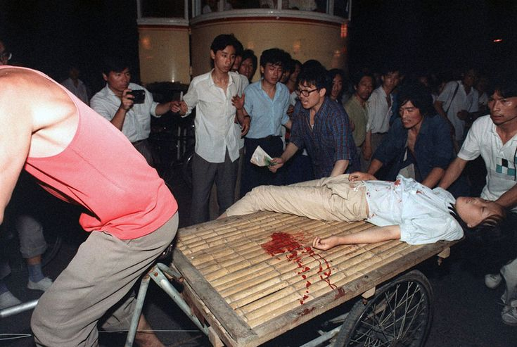 A girl wounded during the clash between the army and students near Tiananmen Square is carried out by a cart, on June 4, 1989. (Manuel Ceneta/AFP/Getty Images) #