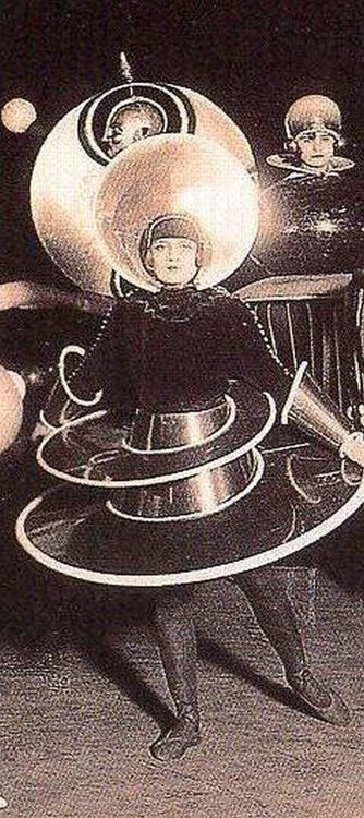 Triadisches Ballett (Triadic Ballet) is a ballet developed by Oskar Schlemmer.  The ballet became the most widely performed avant-garde artistic dance and while Schlemmer was at the Bauhaus from 1921 to 1929, the ballet toured, helping to spread the ethos of the Bauhaus.