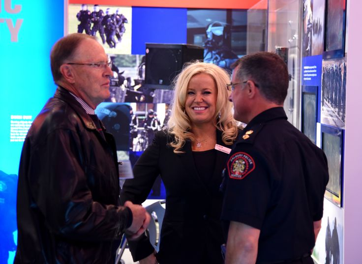 Tara Robinson, our Executive Director, tours some of our Calgary Police Members around the new centre.