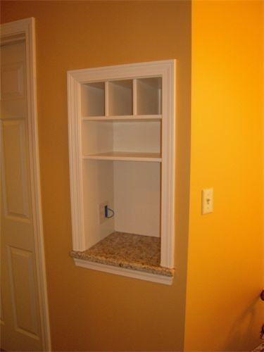 Between the studs – Built in nook for purses, cell phones, mail! And an outlet on the middle shelf would allow for recharging station