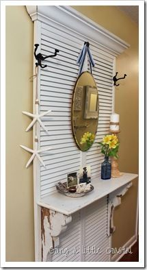 old louvre doors/shutters, a cornice, a shelf and 2 shelf cornice thingies and voila, a hallstand.