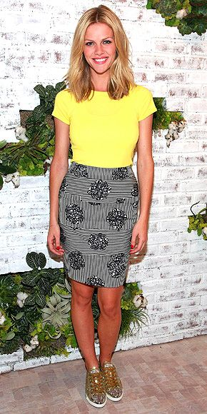 BROOKLYN DECKER  The Battleship beauty lends a little sparkle to her lemon Splendid tee and mesmerizing skirt with high-shine gold kicks at the brand's store opening in Soho.