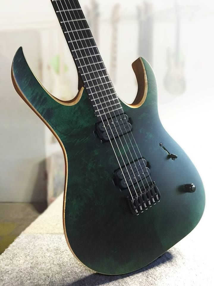"Mayones Duvell 6 Elite, Eye Poplar top, Transparent Dirty Green Satine finish, Mahogany Sapele body - Trans Natural Satine finish, Bolt-on construction, 5-ply Wenge/Bubinga neck, Ebony fingerboard, 16"" fingerboard radius, 25.4"" scale, 24 Ferd Wagner Stainless Steel extra jumbo frets, Luminlay SB-20 Super Blue side dot markers, Seymour Duncan Nazgûl (bridge) and Sentient (neck) humbucker set,"