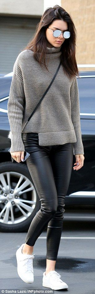 Street chic! Kendall stepped up her style a bit with tight-fitting leather, black pants an...