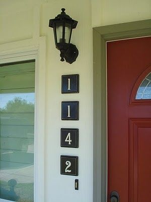 They are just wooden squares from any craft store with metal house numbers... cute!