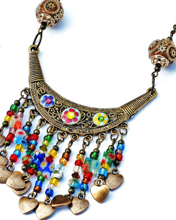 A Boho beauty with a curtain of colorful glass beads and dangling hearts! FREE US SHIPPING! https://www.etsy.com/listing/475380709/boho-bib-necklace-free-shipping-colorful
