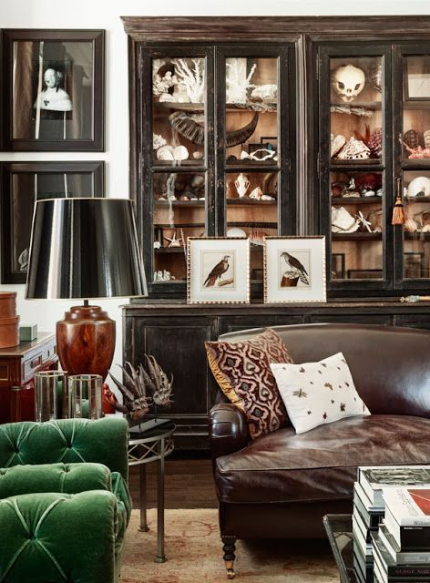 curiosity cabinet . leather sofa . green chair . sophisticated living space . via sadieandstella.blogspot.com