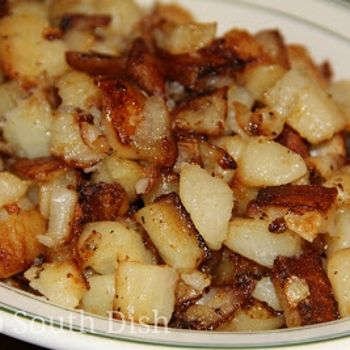 Southern Fried Breakfast Potatoes Recipe -About 1/2 cup of vegetable or canola oil, bacon fat, butter, or any combination 2 pounds of russet potatoes (about 4 to 5), peeled and diced 1/2 cup of finely chopped onion Salt and pepper, to taste added red pepper flakes and some garlic powder too.