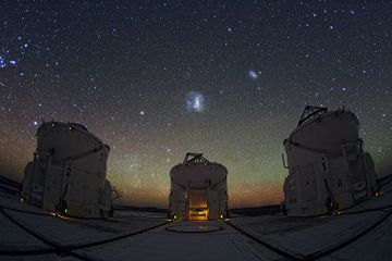 The night sky gleams with stars, nebulas and galaxies over ESO's Paranal Observatory in Chile. Three of the four moveable VLT Auxiliary Telescopes stand below the majestic sky. The units feed light into the Very Large Telescope Interferometer, creating a telescope greater than the sum of its parts. Image released Jan. 6, 2014.