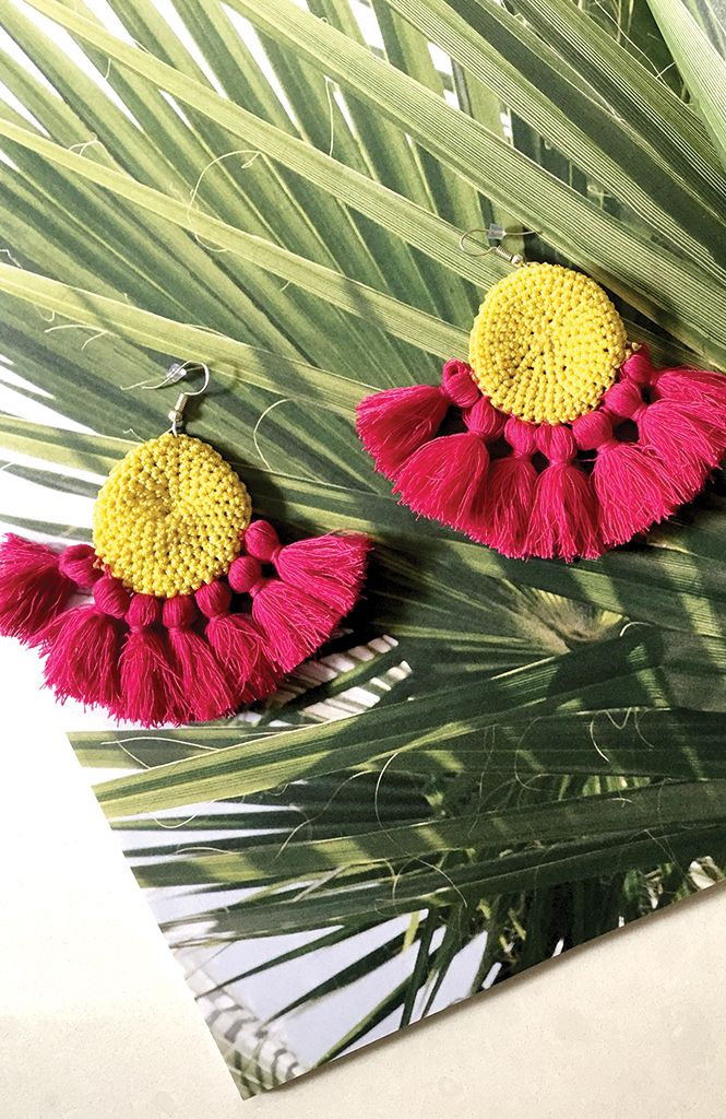 Fiesta Earrings - Shop vacation-worthy styles at TRAVELLERS' ROBE – You'll be certain to make an entrance in these statement Fiesta Earrings. Features pink tassel details and yellow crochet centre for a totally unique look. Shop it now, Xo Jayde TRAVELLERSROBE.COM