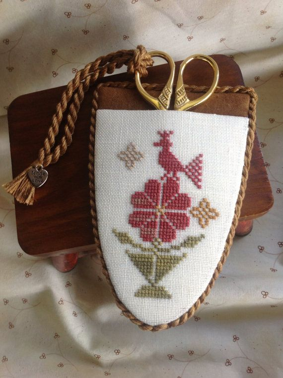 Hand stitched cross stitched sampler style floral motif scissor case.