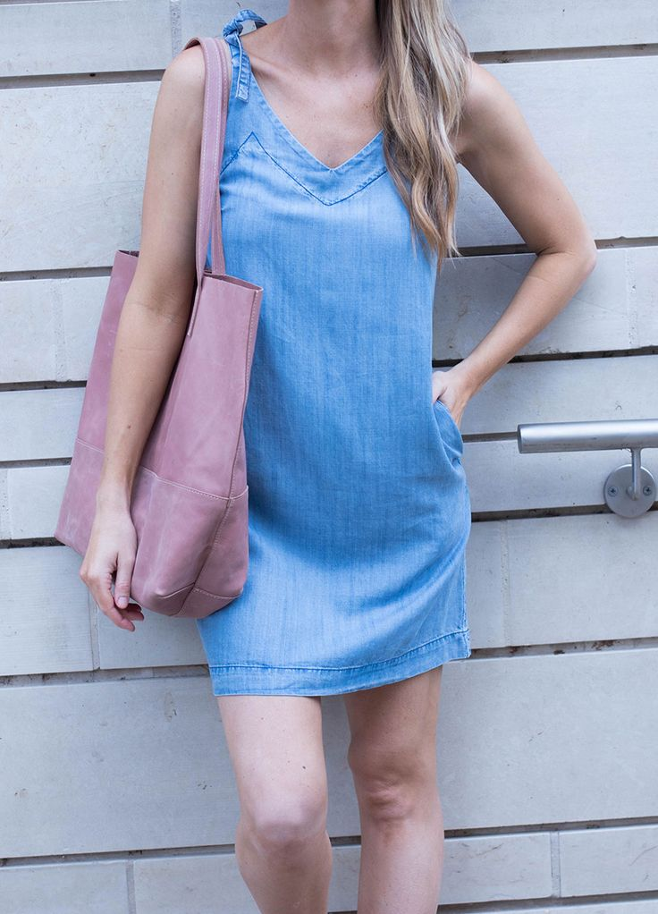 I paired the dress with my favorite blush pink tote, and blush espadrille sneakers. Chambray and blush go together perfectly, and I think I will be wearing this look a lot this summer! This dress is a staple that will lasts for multiple summers.