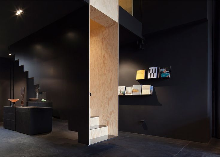 Boxed-in floating staircase forms centrepiece inside Berlin homeware store