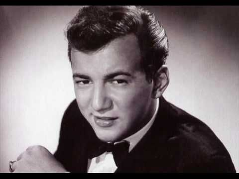"""Bobby Darrin, """"Mack the Knife."""" [T]he standard from Kurt Weill's Threepenny Opera, was given a vamping jazz-pop interpretation. Although initially opposed to releasing it as a single, the song went to No. 1 on the charts for nine weeks, sold two million copies, and won the Grammy Award for Record of the Year in 1960."""" [Wikipedia]"""
