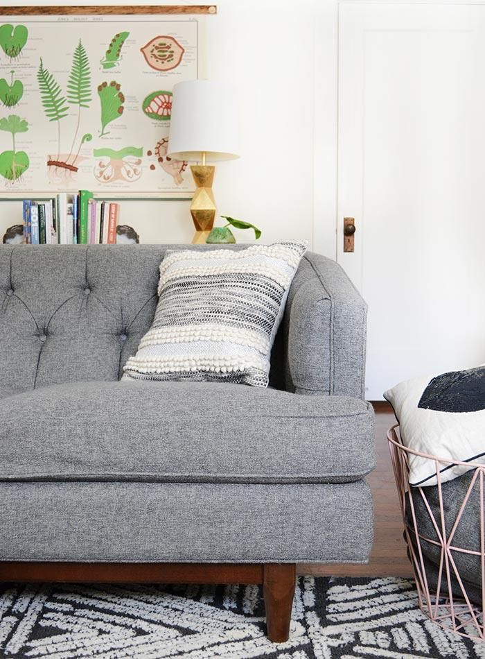 Grey Love Seat With Cream And Grey Pillows (see The Citizenry), Coco  Carpets, Geometric Lamps.