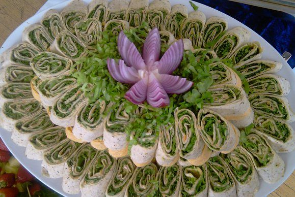 Vegan Vegetable Pinwheels (No recipe use your own hummus, cashew cream, and veggies) Picture is for inspiration for a buffet table.