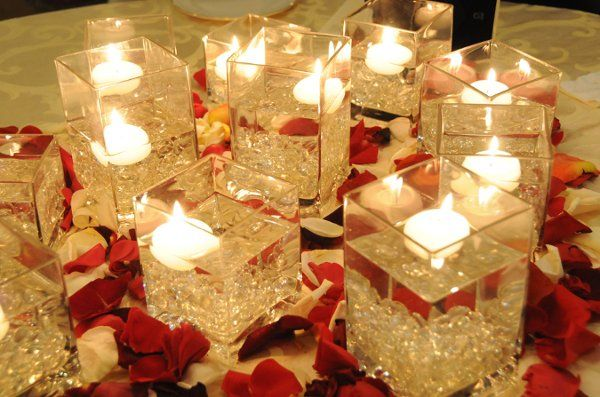 Red and gold wedding reception table decorations car