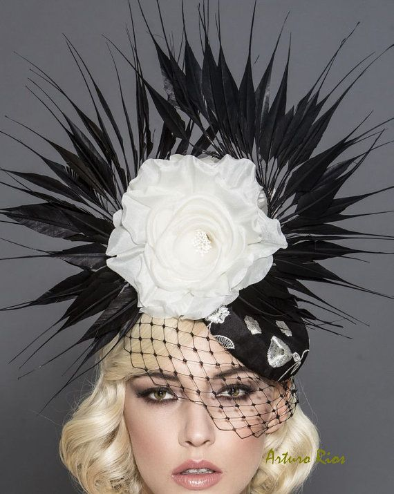 Beautiful black and white headpiece from my 2016 Derby collection. Made on a flat pillbox base covered with black silk with white embroidered roses, Russian netting, pointy goose feathers and 2 off white Silk roses. It includes an elastic string to secure it around your head, its pretty light and easy to wear. All my headpieces are hand made to order, please allow 1-2 weeks while we make it.. if this is a rush order, please contact me first to make sure i can make it on time. All sales are…