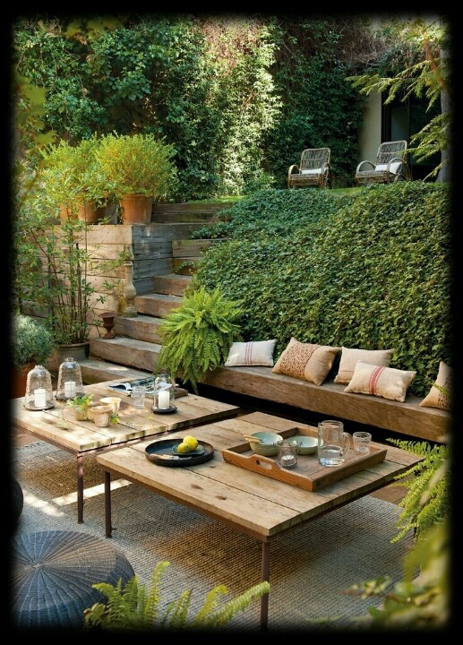 Nice outdoor entertaining area...love the natural wooden bench