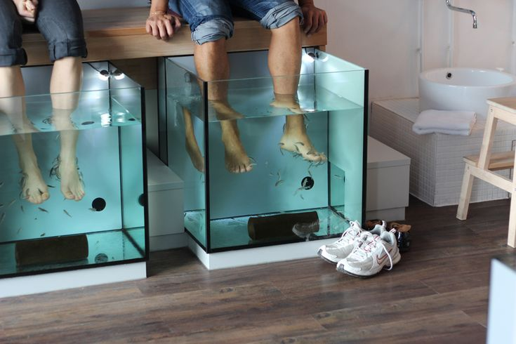 African American Pedicure | Doctor fish swarm around the feet and nibble away at the dead dry skin